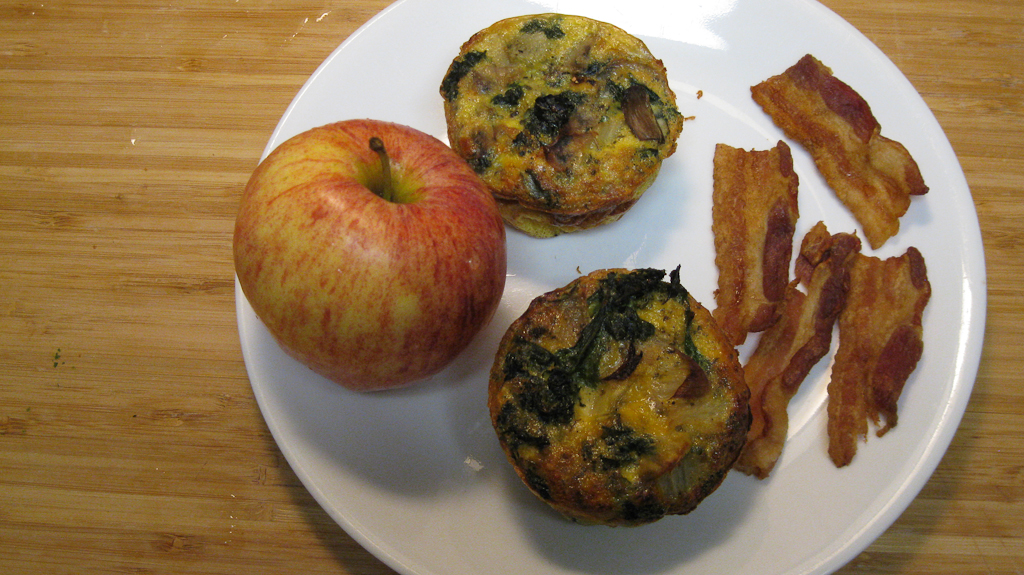 Paleo Breakfast bacon eggs and an apple